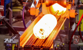 A hot billet exits an induction heating system