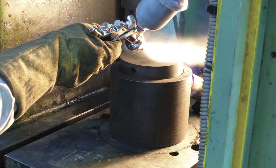 Forging die lubricant is applied to a ring compression test