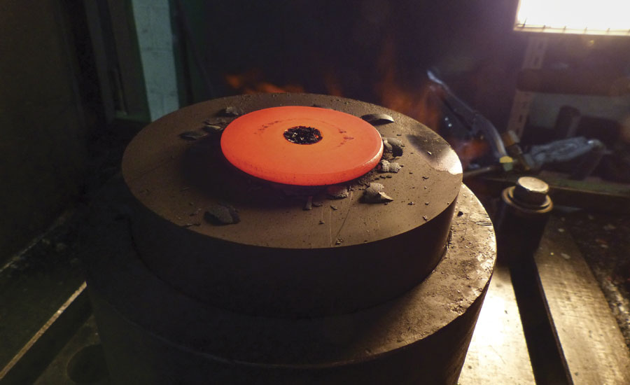 Steel ring being headed prior to forging