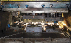 Spring-loaded upper dies used in the closed-die flashless forging of preforms