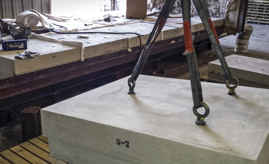 Precast refractory hearth blocks rigged prior to installation